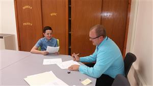 Student interviewing with Principal Ford