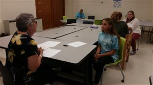 Student interviewing with Mrs. Cracchiola